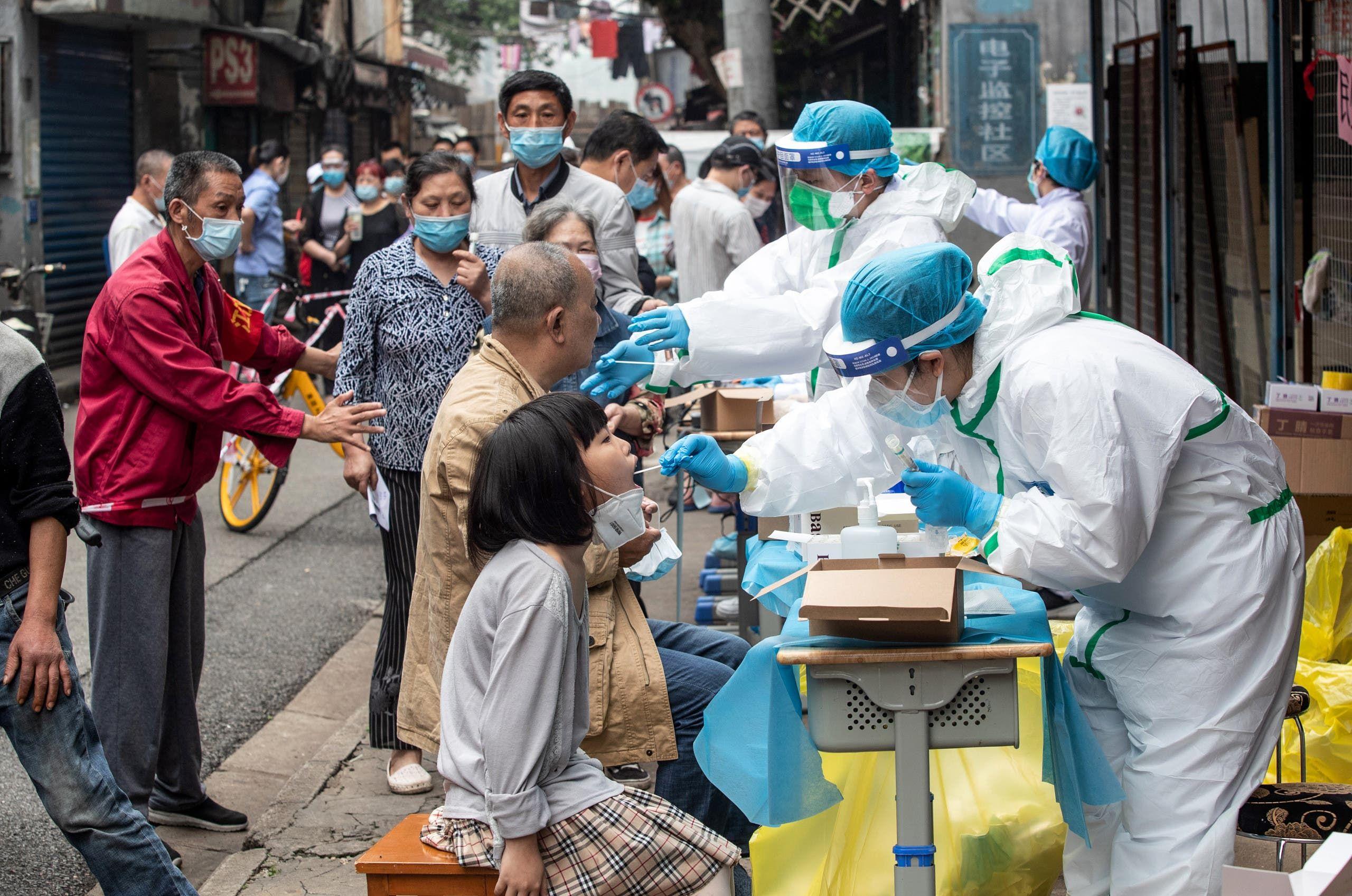 من مدينة ووهان الصينية حيث ظهر كورونا لأول مرة في ديسمبر (أرشيفية- فرانس برس)