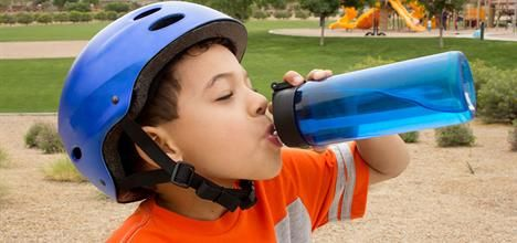 young-boy-taking-a-break-from-riding-his-bike