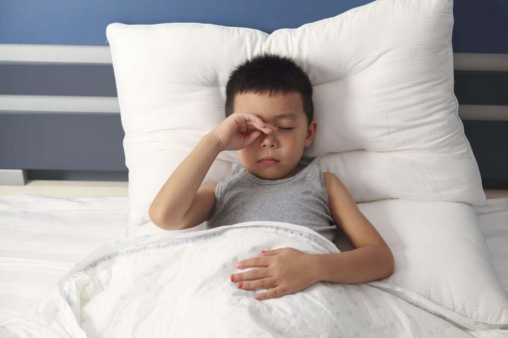 Sleepy.boy_.bed_.rubbing.eye_